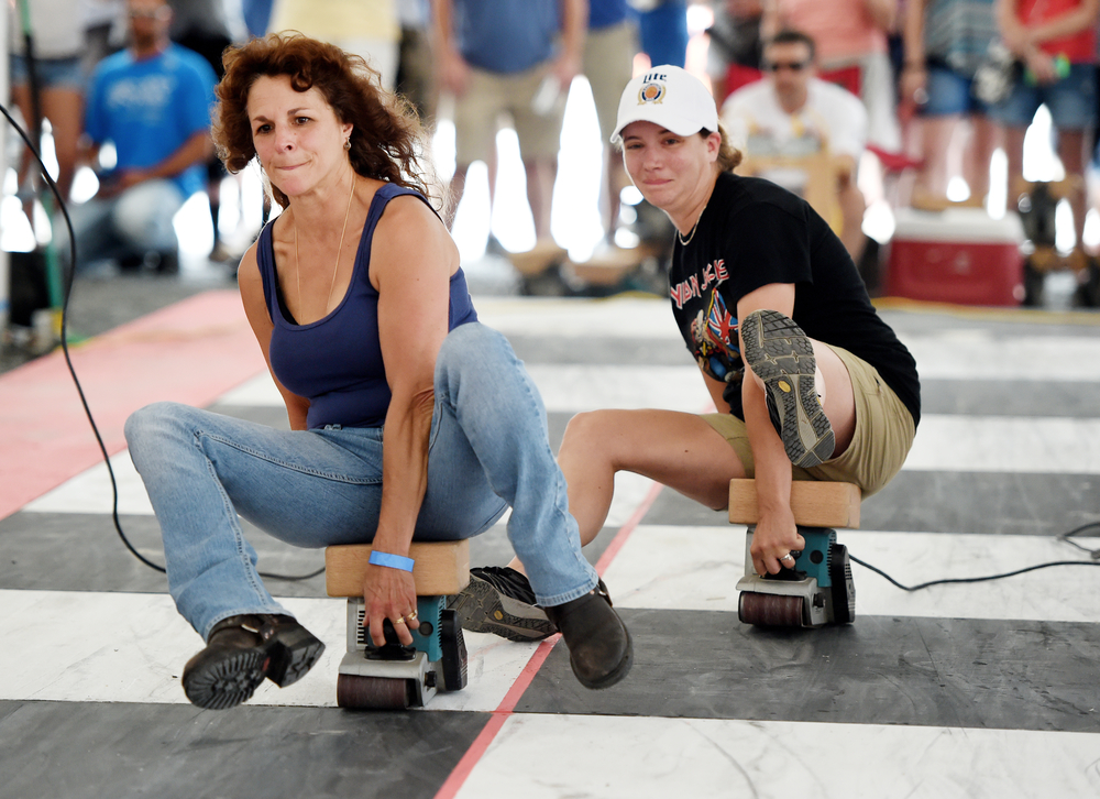 Denise Zerbe of Exeter (left) races against Amber Shubert of Boyertown at the 26th Annual Belt Sander Race at Bertie's Inn in Exeter Township on July 16, 2016. The race benefits the National Multiple Sclerosis Society of Greater Delaware chapter. (Reading Eagle: Sarah Stier)