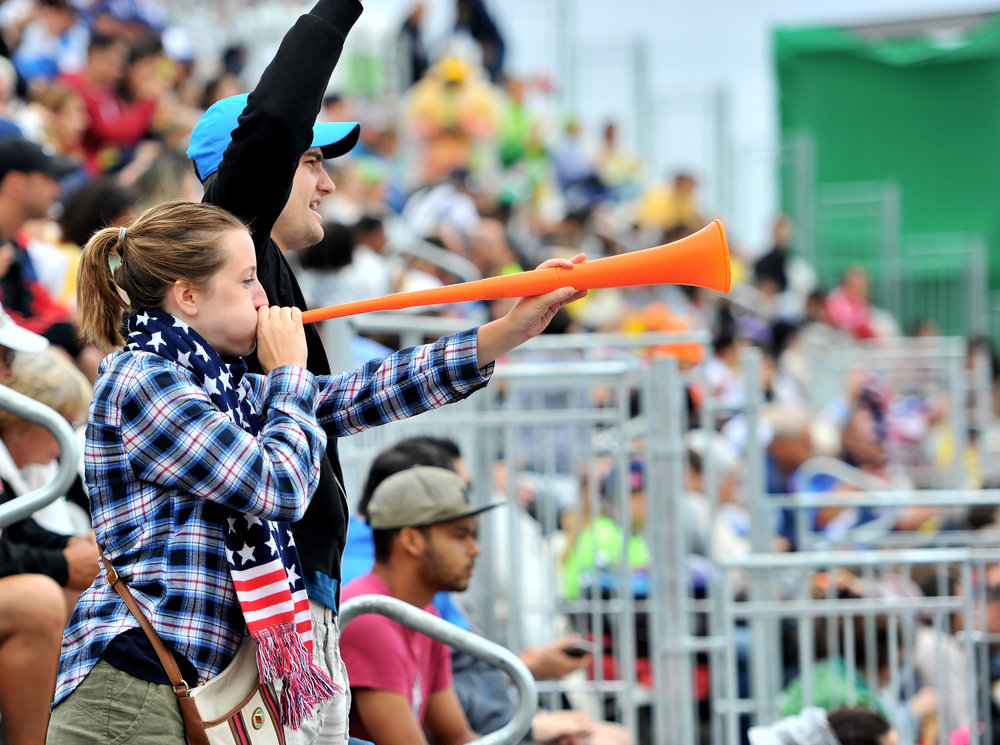 Sammie Hill (left) and Zach Beattie (right) of Washington, D.C., cheer at the U.S. Men's Beach Volleyball game against Spain at Copacabana Beach in Rio de Janeiro, Brazil, on August 10, 2016. (Sarah Stier | Ball State at the Games)