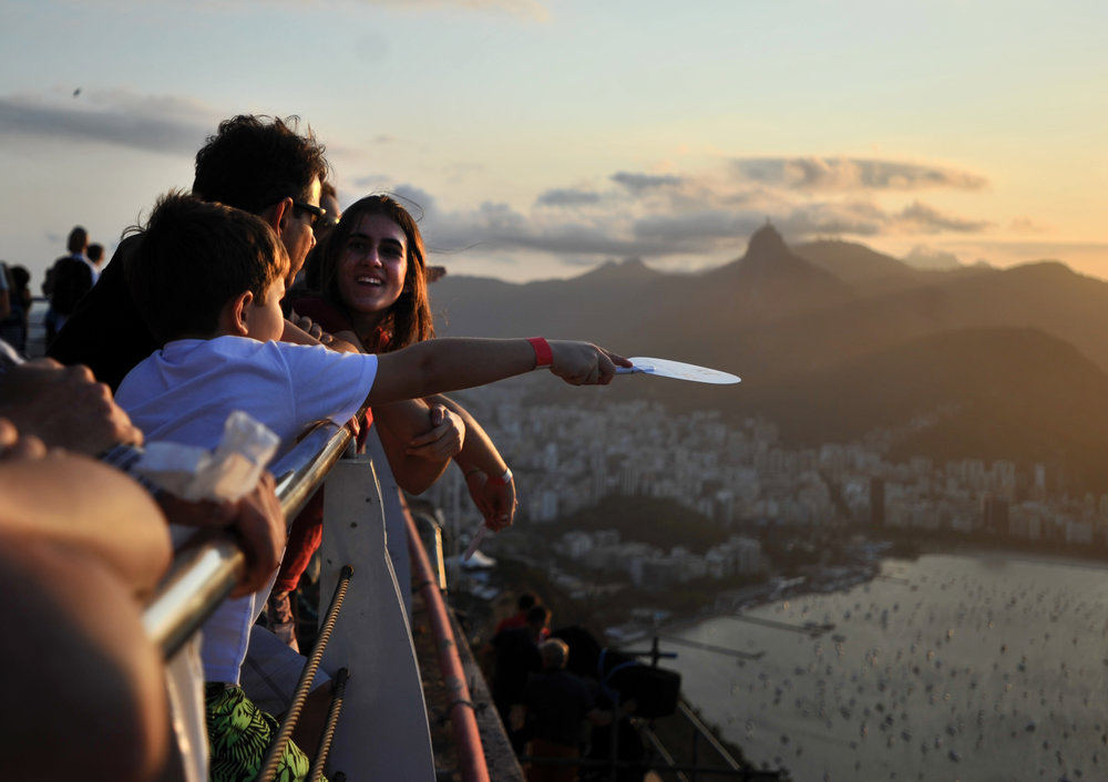 Bruno (left), 7, Leticia (right), 13, and their father Joaquin take in the view atop Sugarloaf Mountain in Rio de Janeiro, Brazil, on August 4, 2016. The family is from Belo Horizonte, Minas Gerais, Brazil. (Sarah Stier | Ball State at the Games)
