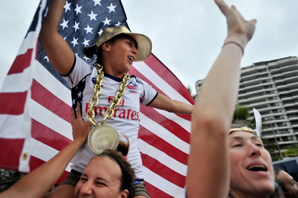 Katie Miller sits atop Rachel Wardley's shoulders while holding an American flag during the Today Show broadcast at Copacabana Beach in Rio de Janeiro, Brazil, on August 8, 2016. The women travelled from Washington, D.C., with their friend Rosemary Wardley. (Sarah Stier | Ball State at the Games)