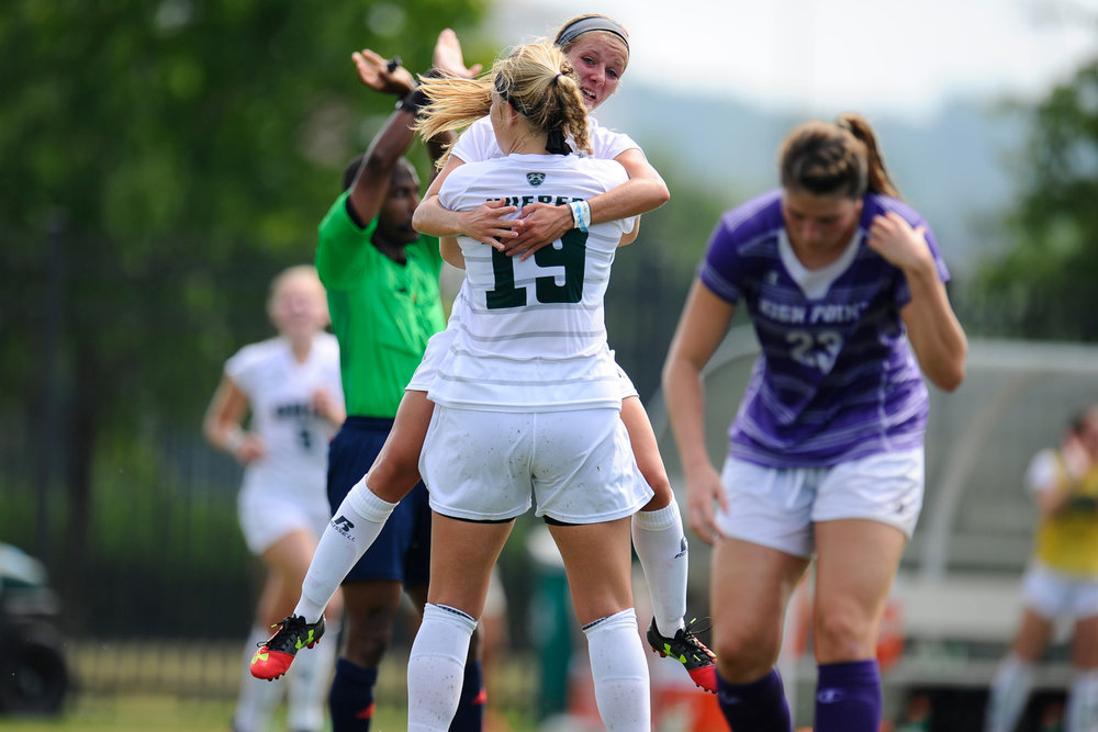 Bryce Hueber (19) and Sydney Leckie (18) embrace after scoring a goal for the Bobcats during their game against High Point on August 28, 2016, in Athens, Ohio. The Bobcats lost the game in overtime.
