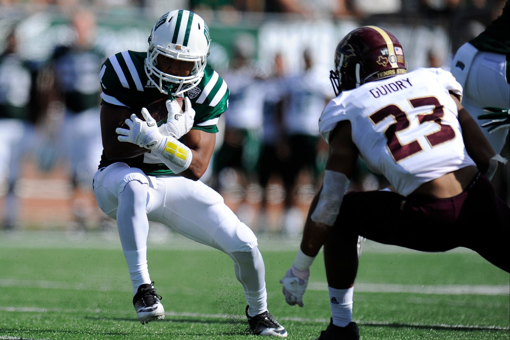 Ohio's sophomore running back Papi White carries the ball during the game against Texas State on September 3, 2016, in Athens, Ohio. After a back and forth game that went into triple overtime, the Bobcats dropped the game to Texas State 56-54.