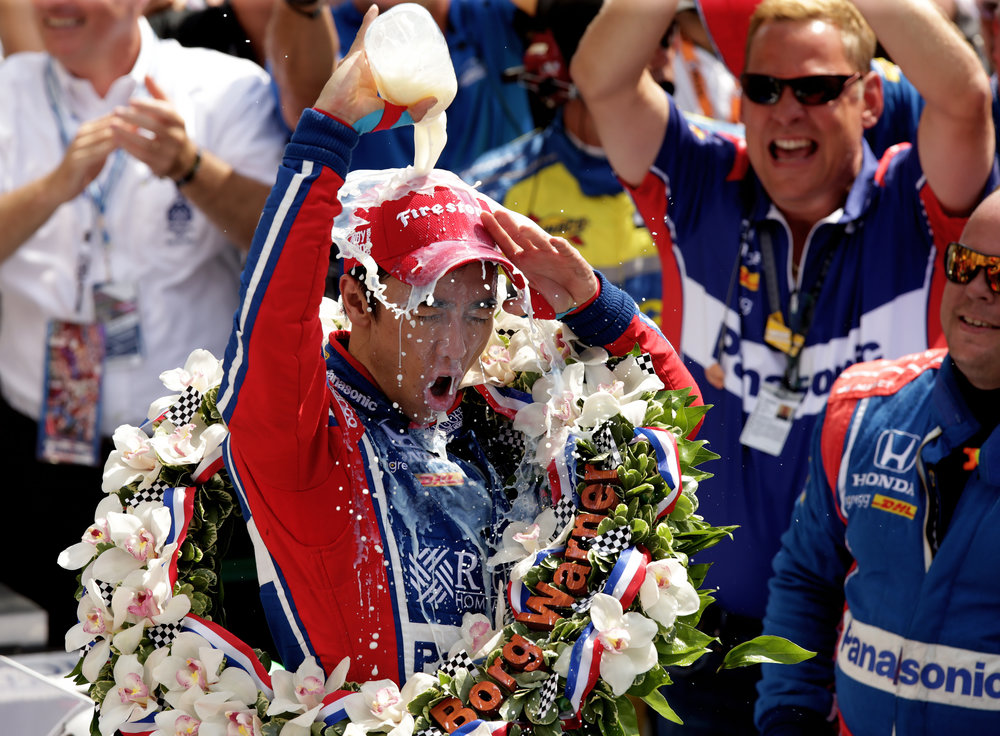 Andretti Autosport IndyCar driver Takuma Sato celebrates his 2017 Indy 500 win with the iconic milk drink in Victory Lane at Indianapolis Motor Speedway on Sunday, May 28, 2017. This was his first Indy 500 win.
