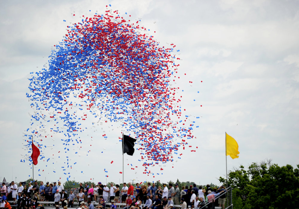 "Balloons are released during Jim Cornelison's performance of ""Back Home Again in Indiana"" at the 101st running of the Indianapolis 500 at Indianapolis Motor Speedway on Sunday, May 28, 2017."