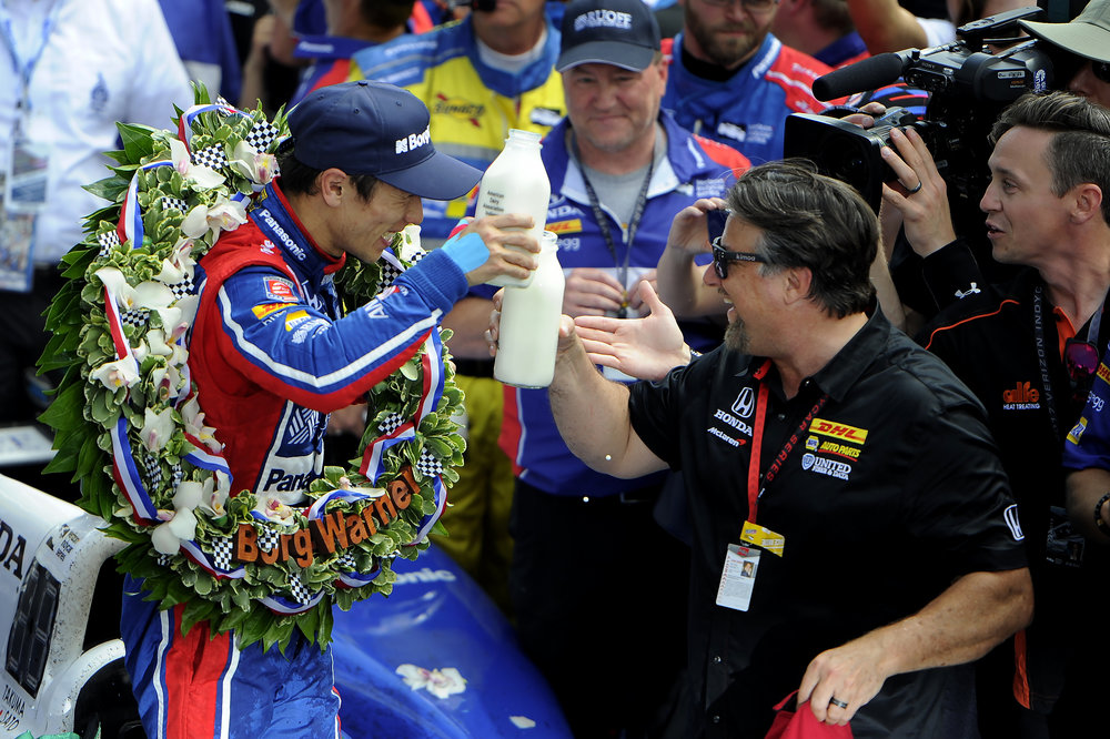 Andretti Autosport IndyCar driver Takuma Sato celebrates his 2017 Indy 500 with Michael Andretti in Victory Lane at Indianapolis Motor Speedway on Sunday, May 28, 2017. This was his first Indy 500 win.