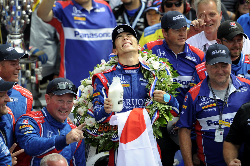 Andretti Autosport IndyCar driver Takuma Sato smiles hard, overcome with joy after winning the 2017 Indy 500. This was his first Indy 500 win.