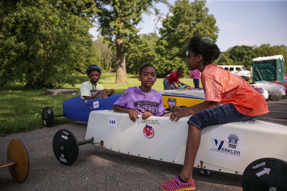 Terrell Richardson (left), 10, and Tiffany Richardson, 10, socialize before their race at the 15th Annual Mayor's Cup on Saturday, June 3, 2017. The organization that organizes it, Indianapolis Soap Box Derby, aims to get younger, underprivileged children involved in a sport that is very hands-on.