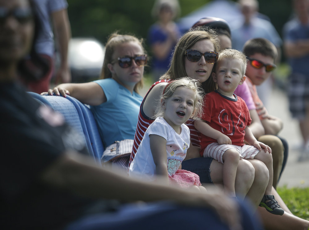 Ashley Lauogh watches the derby car races with her son Cohen, 2, and Myla, 4, at the 15th Annual Mayor's Cup on Saturday, June 3, 2017.