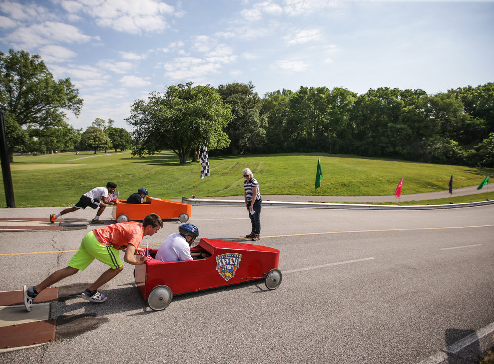 "Henry Paul (left) pushes Deputy Mayor David Hampton down the derby hill during the 15th Annual Mayor's Cup on Saturday, June 3, 2017. The first few races of the day are ""Celebrity Races"" in which elected officials of the community participate in the races."