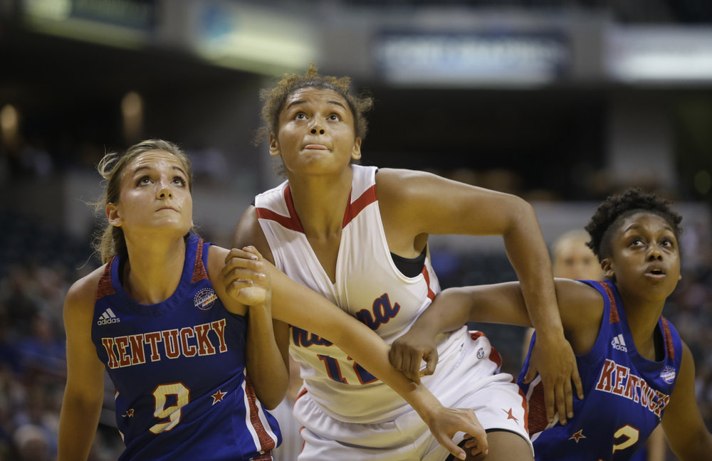 North Central's Ajanae' Thomas (11), Franklin County's Rebecca Cook (9), and Butler's Breia Torrens (3) at the Indiana vs. Kentucky High School All-Star game at Bankers Life Fieldhouse in Indianapolis on Saturday, June 10, 2017.