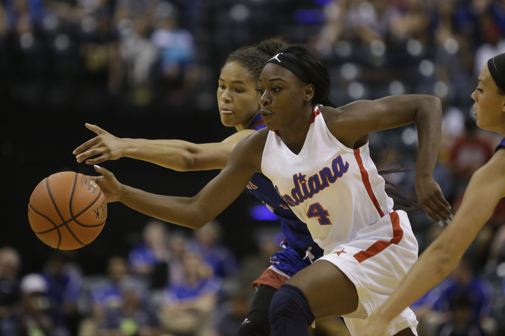 Gary West's Dana Evans (4) at the Indiana vs. Kentucky High School All-Star game at Bankers Life Fieldhouse in Indianapolis on Saturday, June 10, 2017.