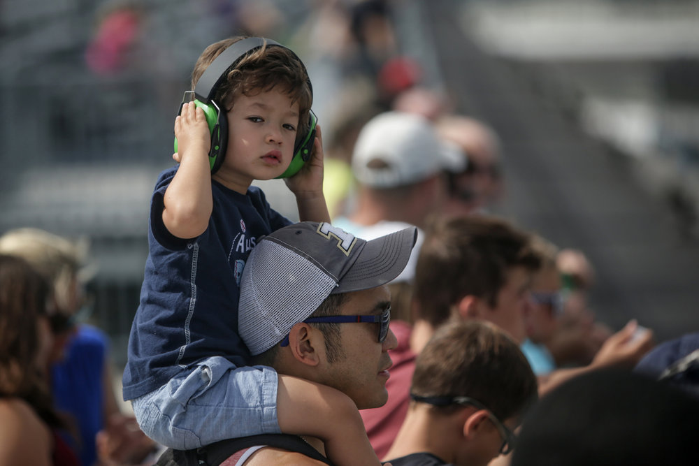Connor Lin, 3, sits atop his father, Mike's, shoulders at the SVRA Brickyard Vintage Race at Indianapolis Motor Speedway on Saturday, June 17, 2017.