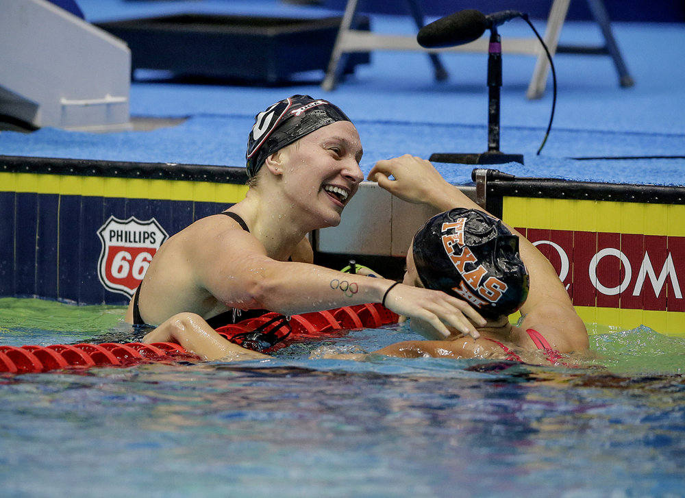 Madisyn Cox (right) congratulates Melanie Margalis (left) after Margalis won the 200-meter Individual Medley at the Phillips 66 National Championships at IUPUI Natatorium in Indianapolis on Saturday, July 1, 2017.