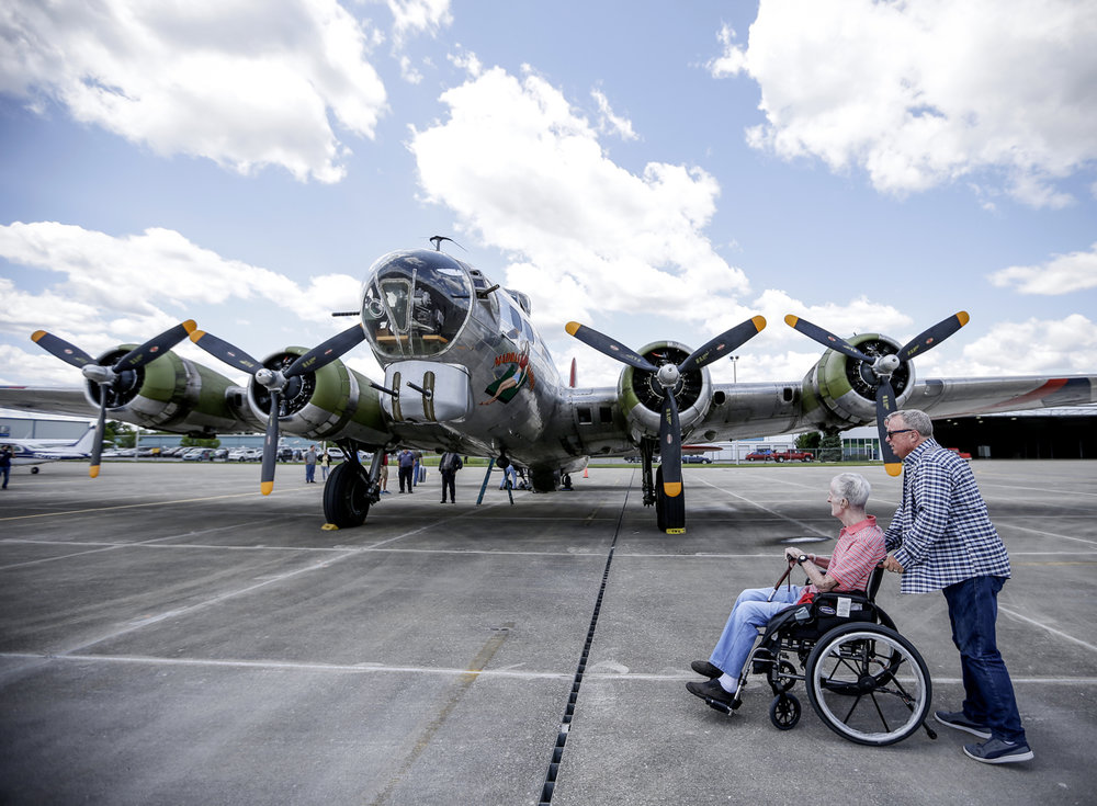 Rick Sutton (right) and his father, Dick Sutton, explore a historic B-17 bomber on Monday, June 26, 2017. The Liberty Foundations 2017 Salute to Veterans tour features flights on World War II-era Boeing B-17 Flying Fortress nicknamed 'Madras Maiden'. Dick Sutton is a Korean War veteran, and served in the military for 34 years.