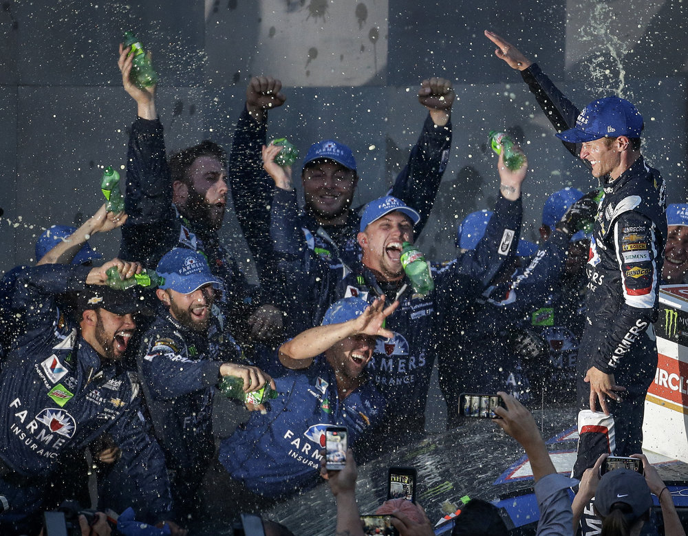Monster Energy NASCAR Cup Series driver Kasey Kahne and his crew celebrate their win with a Mountain Dew shower at the Brickyard 400 at Indianapolis Motor Speedway on Sunday, July 23, 2017. Kahne's win came well-deserved after a grueling race with a rain delay, a record 14 cautions and 7 lead changes.
