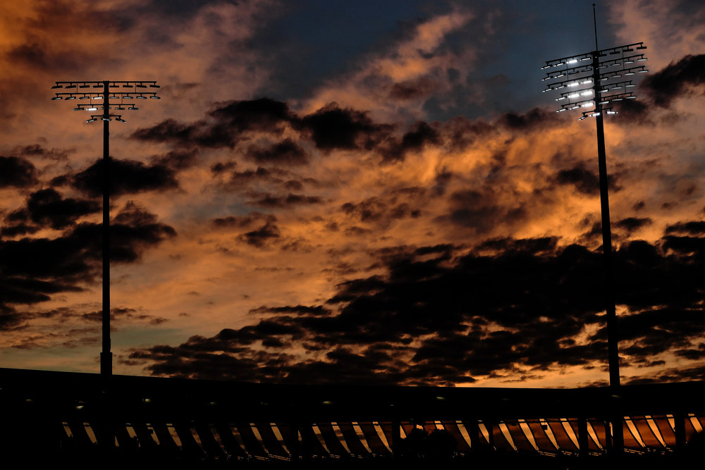 The sun sets over the Grandstand court at the 2018 US Open at the USTA Billie Jean King National Tennis Center on August 31, 2018 in the Flushing neighborhood of the Queens borough of New York City.