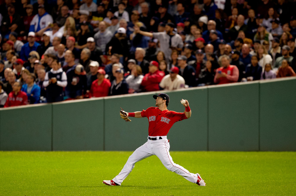Boston Red Sox outfielder Andrew Benintendi throws from the outfield during the game against the New York Yankees at Fenway Park in Boston, Massachusetts, on Friday, September 28, 2018.