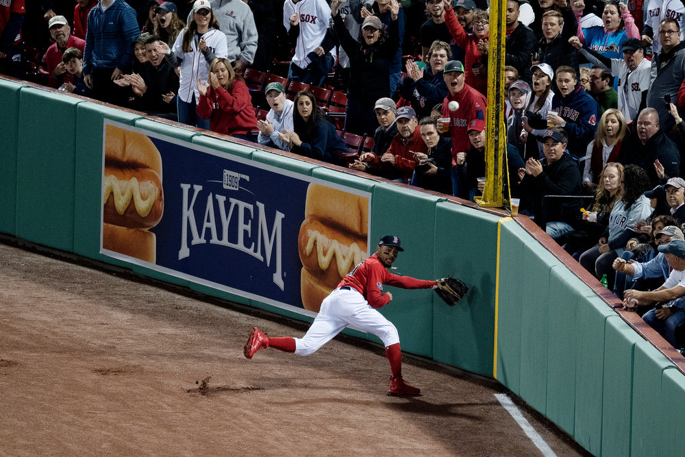 Boston Red Sox outfielder Mookie Betts looks to catch the ball in right field during Game 1 of the ALDS against the New York Yankees at Fenway Park in Boston, Massachusetts, on Friday, October 5, 2018.