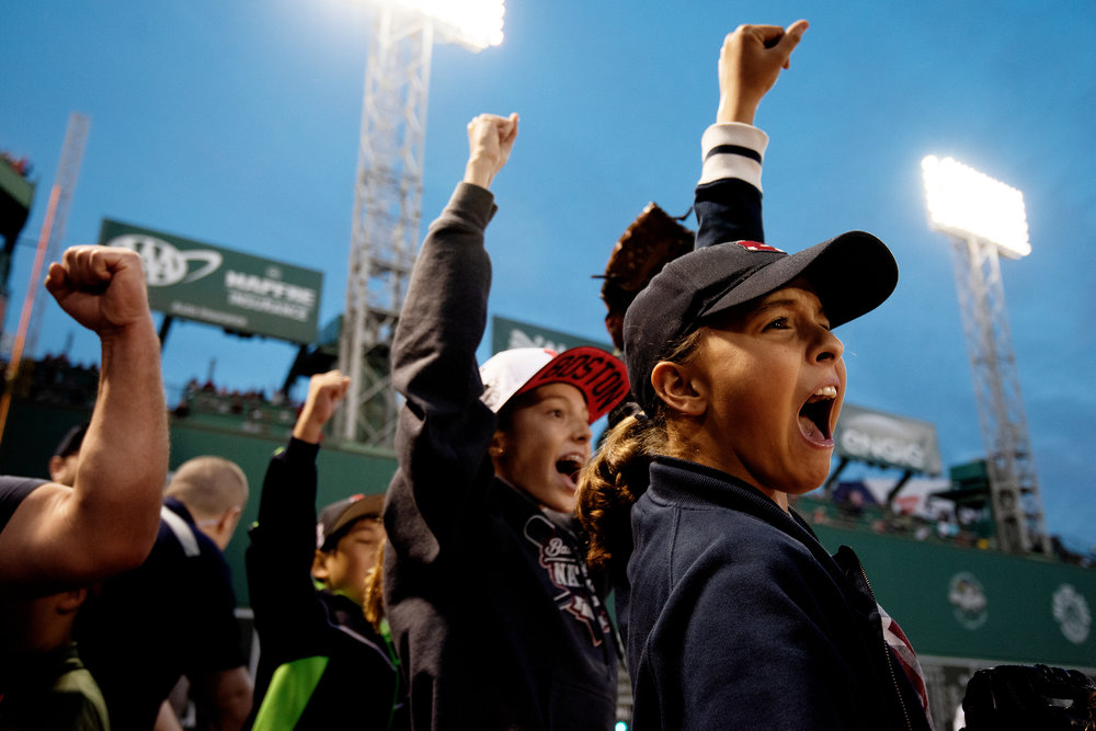 Fans react after the Red Sox's final win of the season over the New York Yankees at Fenway Park in Boston, Massachusetts, on Sunday, September 30, 2018.