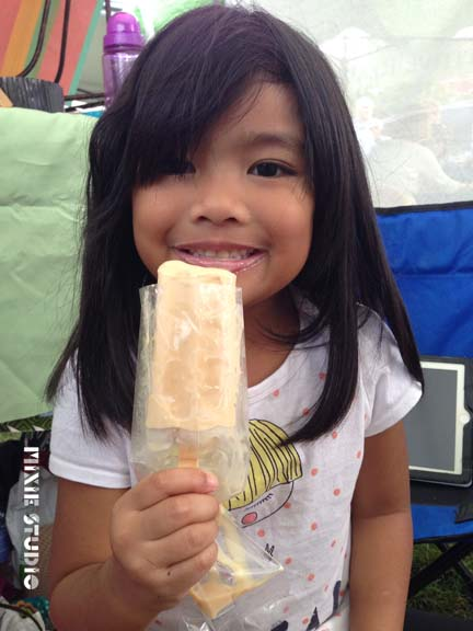Ellie is enjoying a salted caramel treat from Streetpops!