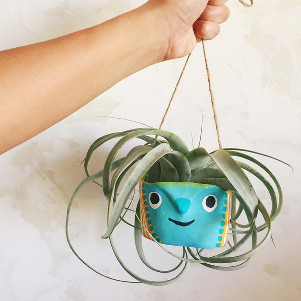 This is another version of our Beast Buddy hanging planters. This one shows how it can hold one large Xerographica air plant! LOVE this guy's hair 'do ;)