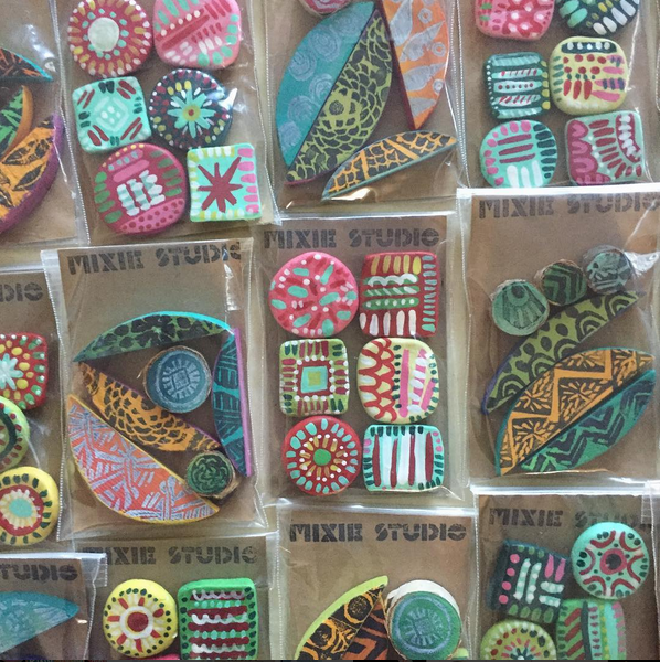 We love mixing and matching patterns! These small magnet sets can add that funky flair to your fridge or magnet boards. We have two types: a set that is sculpted out of paper clay and painted and the other set that is made out of wood that is painted and decorated using our one-of-kind hand-carved stamps.