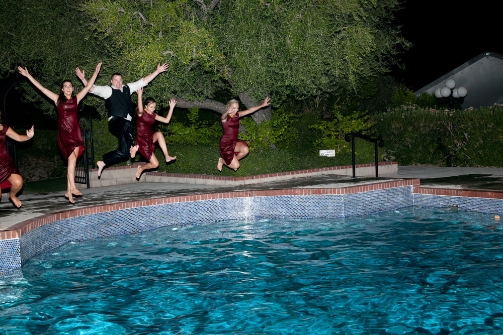 Jumping into a pool with the bridesmaids after a long hot wedding day.