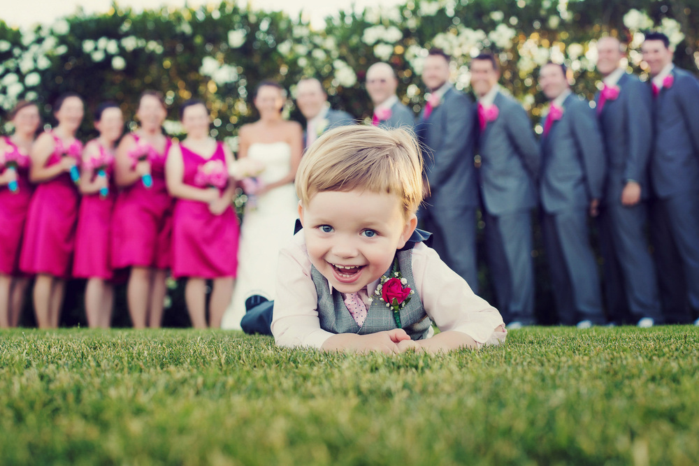 Adorable wedding ring bearer at Millenium Resort