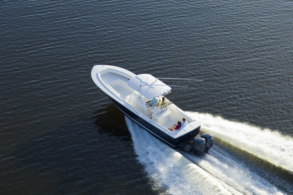 Beautiful shot of a Regulator 34' Center Console heading out for the morning bite. info@kusleryachts.com