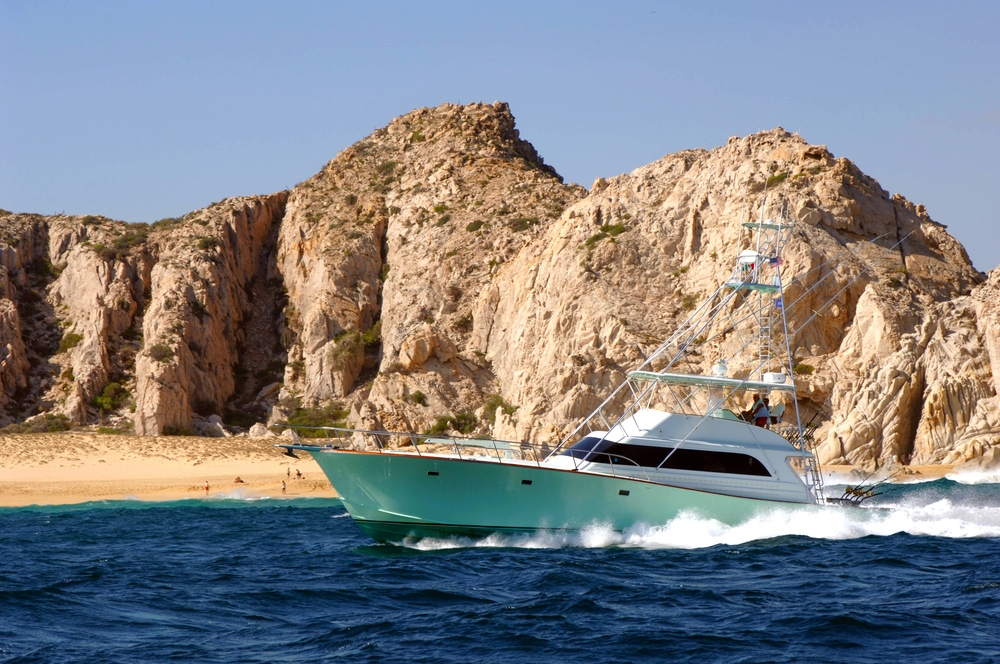 65' Custom Monterey Sportfisher For Sale by Kusler Yachts - Running offshore Cabo San Lucas Mexico.