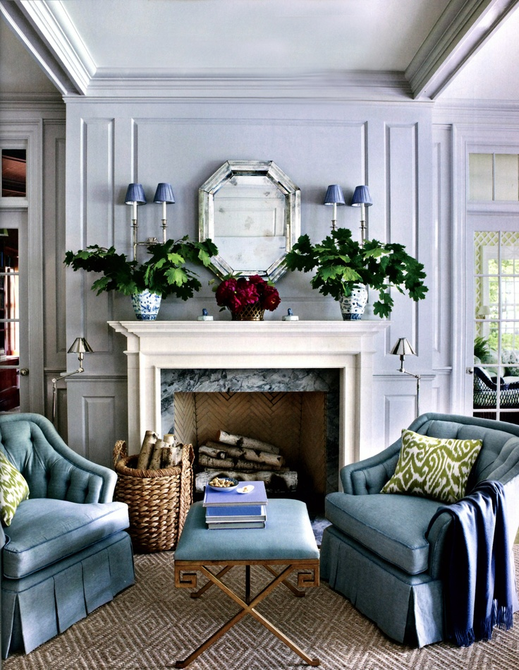 Using symmetrical decor on your mantel is an easy way to create visual balance.