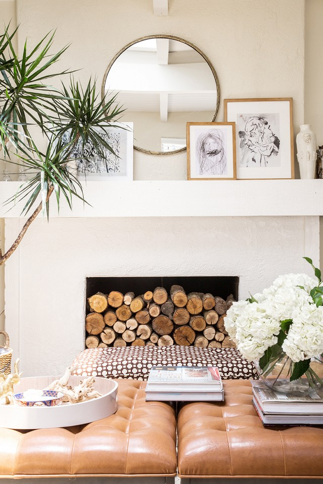 The layered art adds dimension to this mantel giving it visual interest.