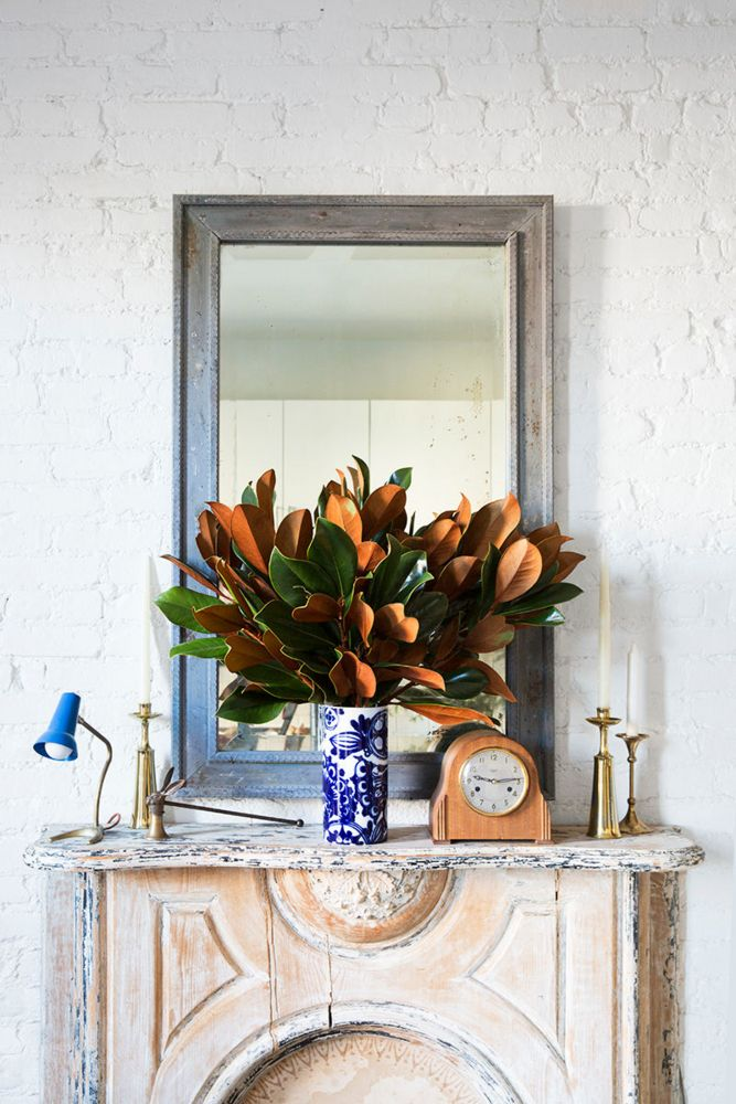Balance, emphasis, dimension, and repitition. A beautiful example of a well-styled mantel.
