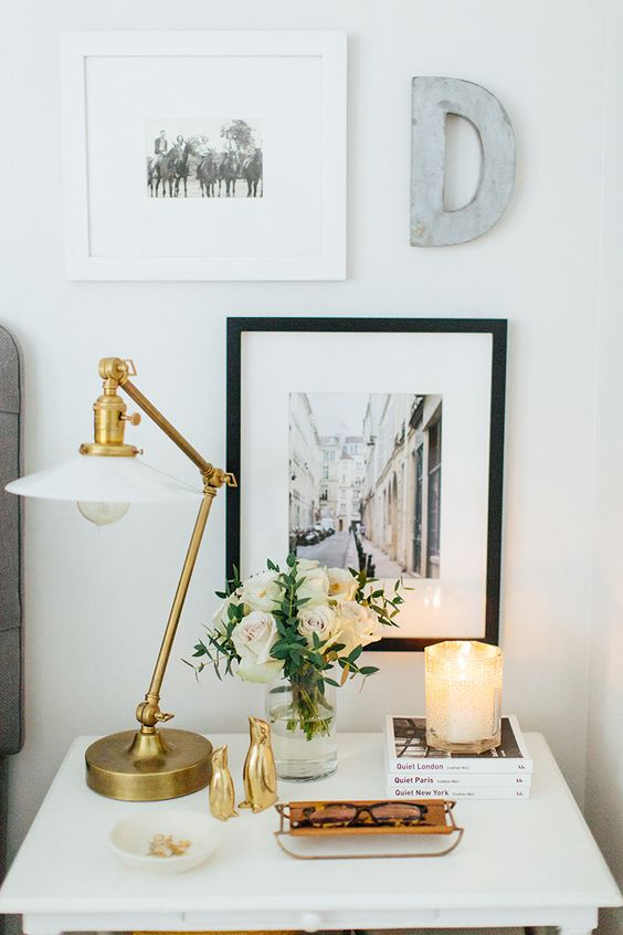 In this image the lamp and hanging art act as something vertical, the glasses and books as something horizontal, and the penguins and flowers as something sculptural! More than one of each category are used and the mix of all three makes it beautiful and balanced.