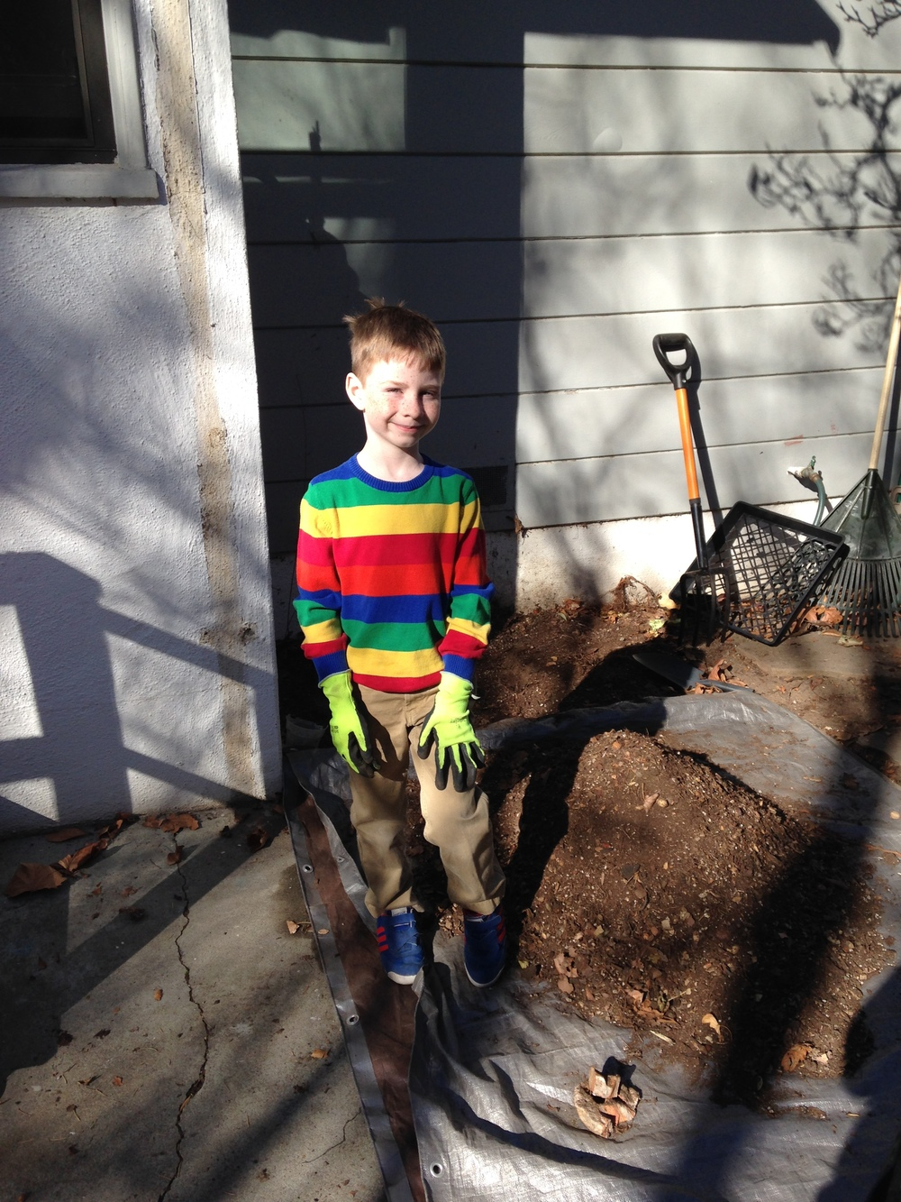 Aidan posing with our new composted soil.