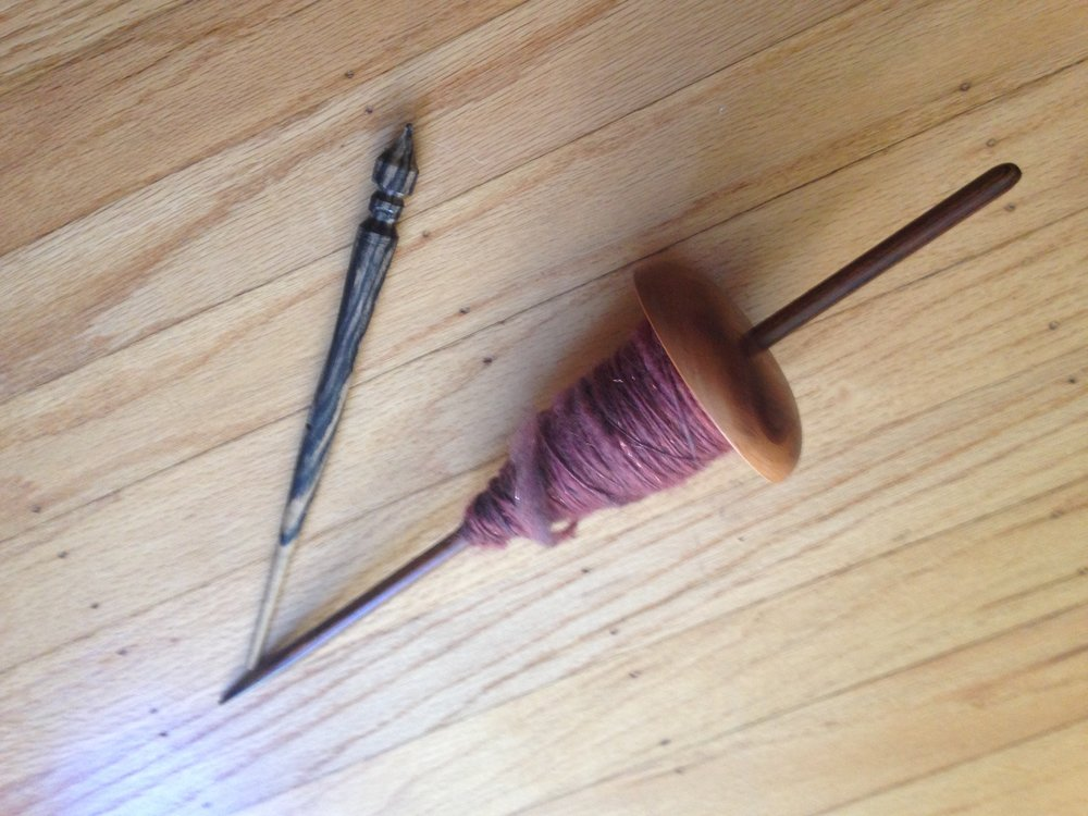 Supported spindles. Navajo spindle with cop.