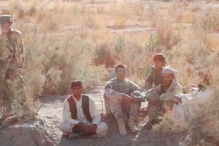 SOHODH founder with local villagers and Afghan police in Kandahar 2010