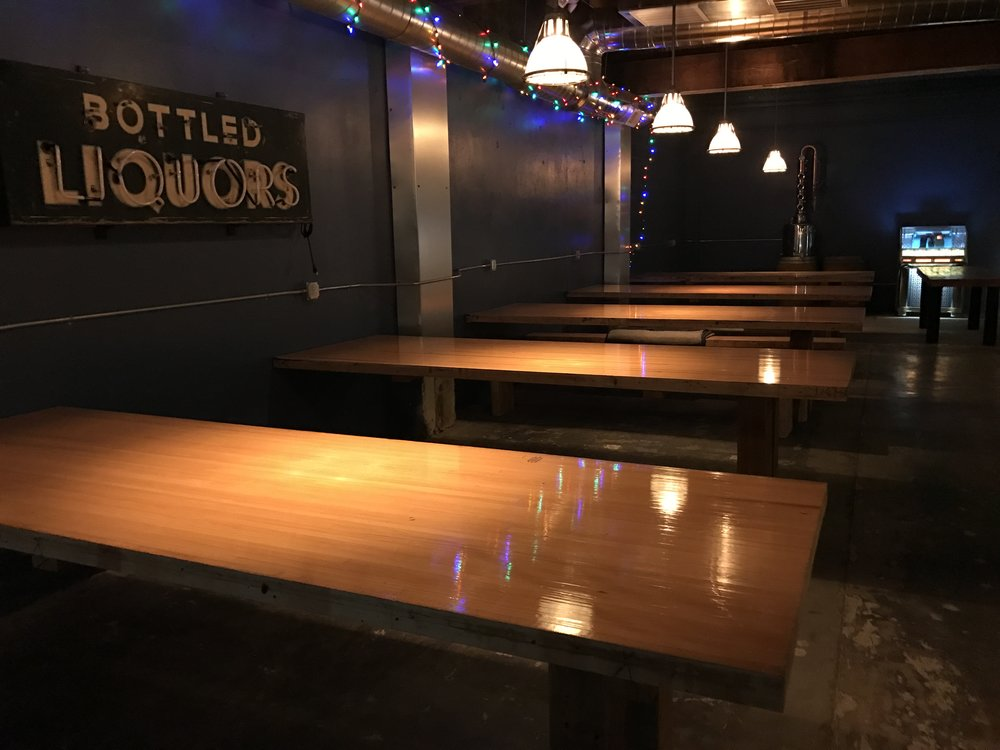 Tables and Jukebox in the Tasting Room Bar