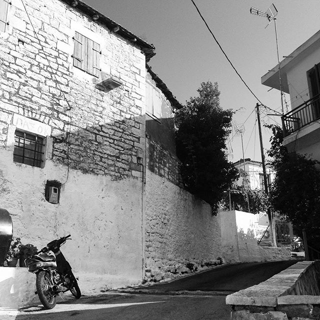 Parked #greece #greekisland #greekholiday #meganisi #trip #travel #summer #vacation #katomeri #motorbike #blackandwhite