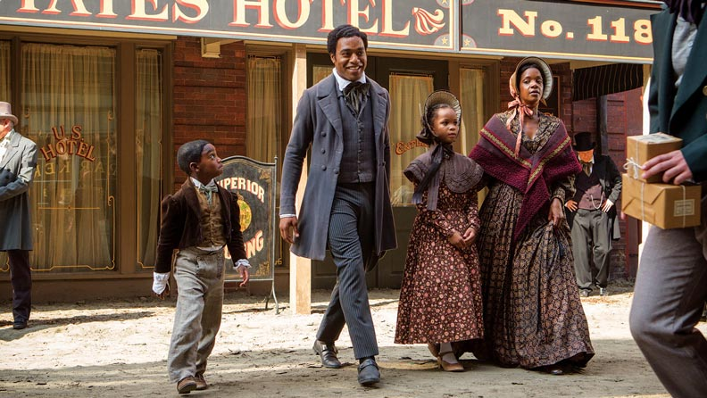 "In a scene from ""12 Years A Slave"", Solomon Northrup happy and free with his family"