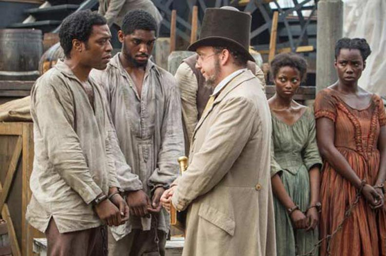 A scene from '12 Years A Slave' with Chiwetel Ejiofor (left) and Paul Giamatti (right)-792