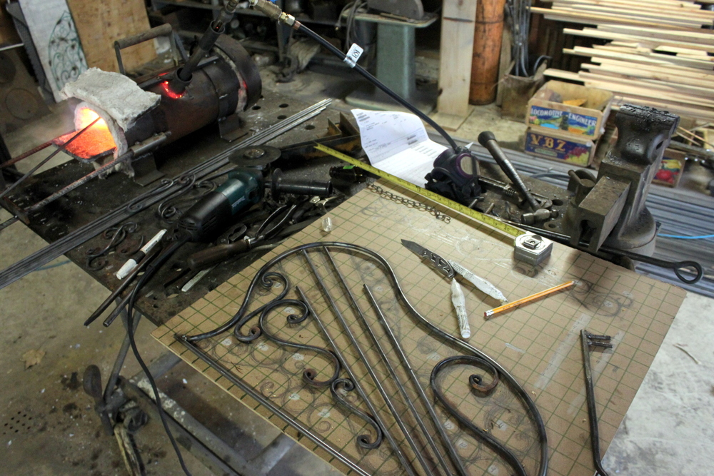 Forging and laying out the pieces for the face. A template was drawn out on board and then each piece of metal was forged and fit into place.