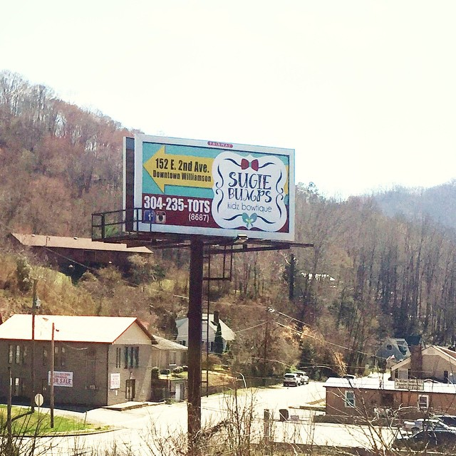 A nice surprise to see the Sugie Bumps Kidz Bowtique logo I designed on a billboard in our hometown! #SugieBumps