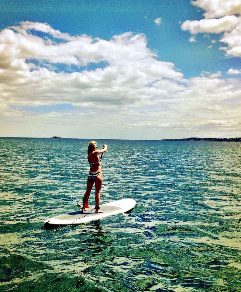 girl paddleboarding king's nahant beach