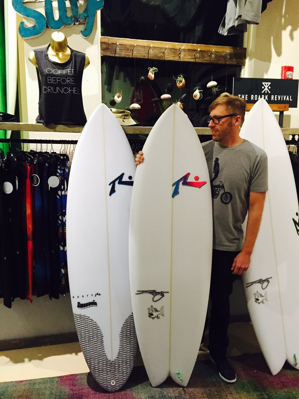 Tim with Rusty surfboards.jpg