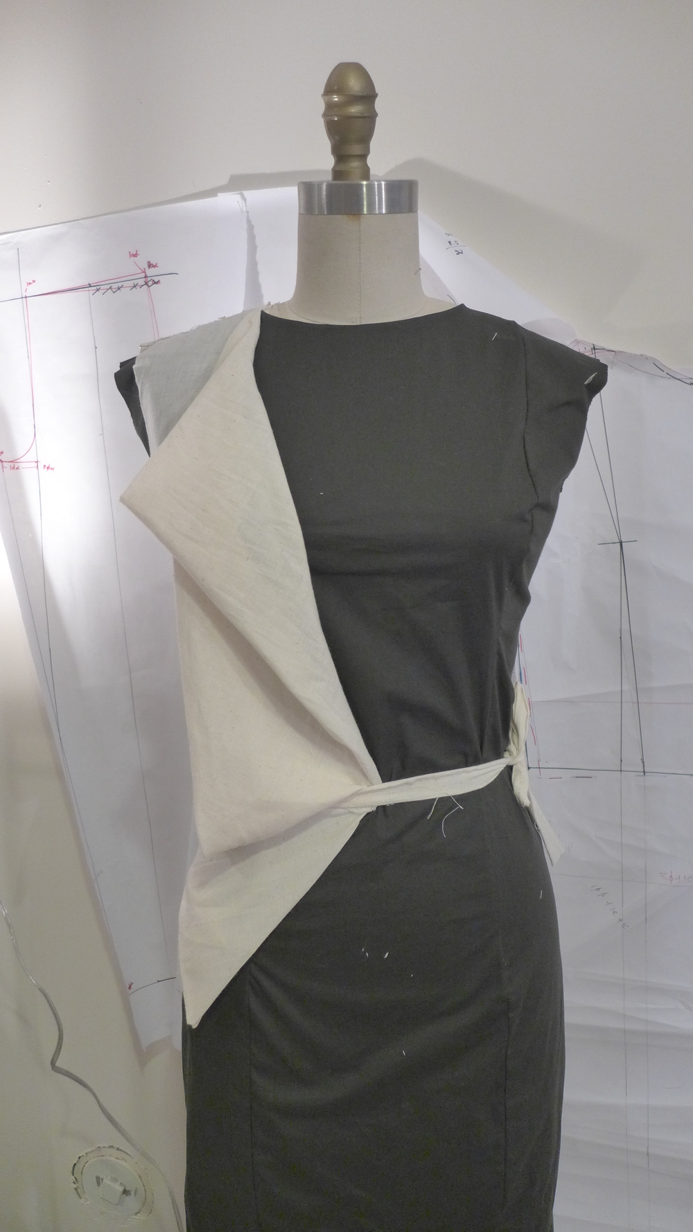 I helped the designers sew up muslins for the next collection and observed their unique draping methods.