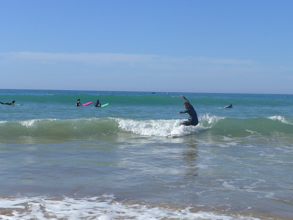 My surf instructor Abdullah shredding the waves, completing a spin