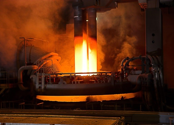 (Figure 3) Electrodes melting steel in the arc furnace.