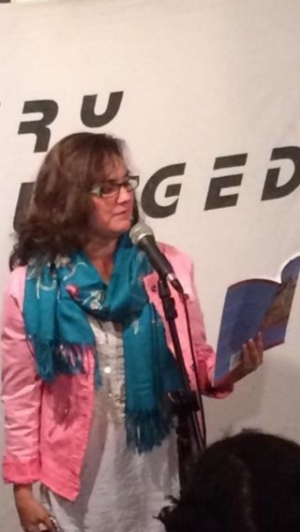 Reading at Poetry Unplugged in London, May, 2015 just days before the crisis year began.