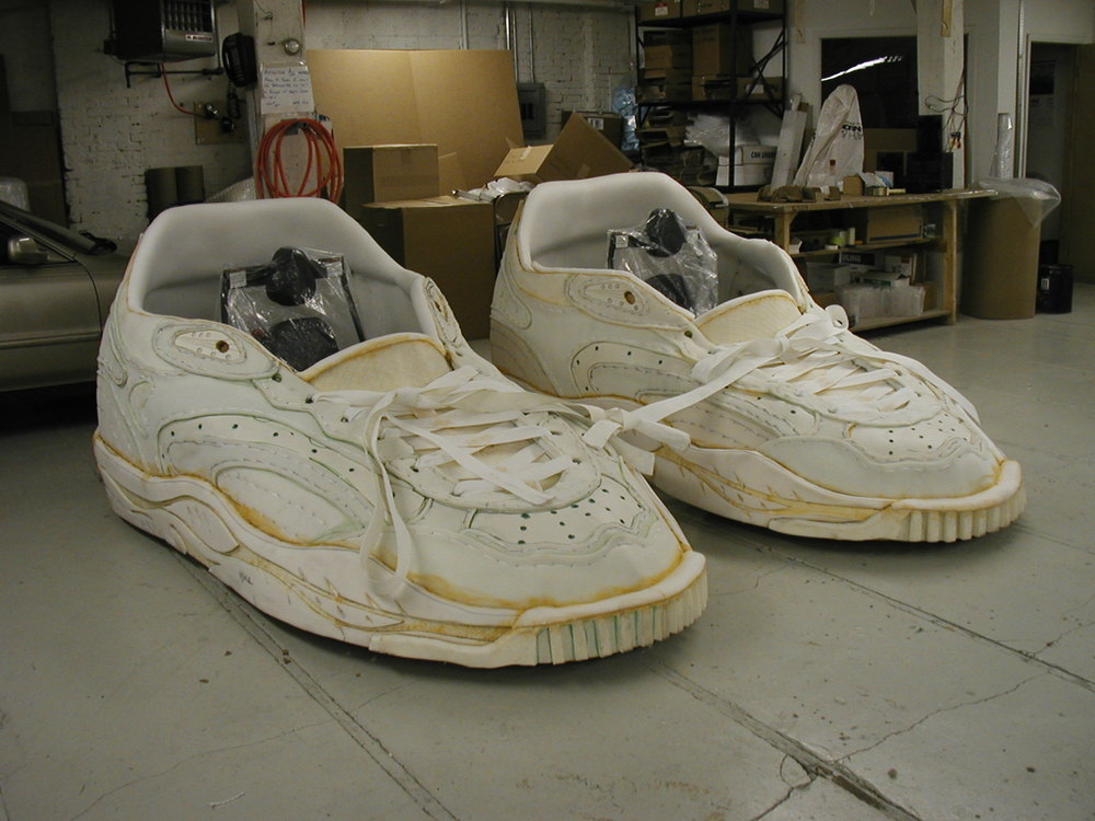 These giant sneakers were built onto go-karts for a trade show event. They were built along with Mortimer Olive Designs for Design Compendium, NYC.